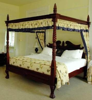 Two American Antique style poster bed mahogany carved