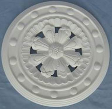 Carved round decor in Antique white finish