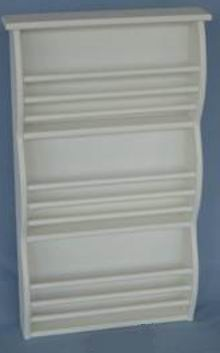 Wall bookrack/wall holder in fully whited covering finish